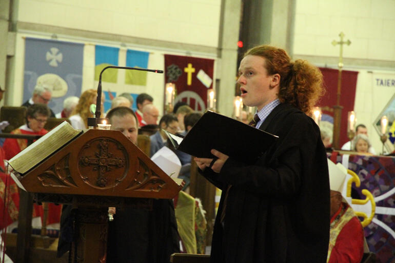 Selwyn choral scholar Patrick Manning sings the litany.