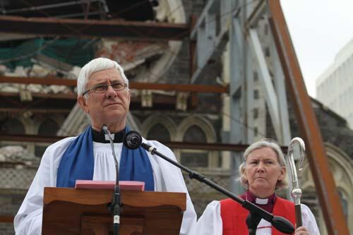 Dean Peter Beck at a service last year in front of the damaged cathedral. Photo: Lloyd Ashton
