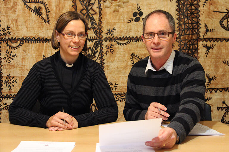 Helen-Ann completes the paperwork confirming her election with the General Secretary of the church, Rev Michael Hughes.