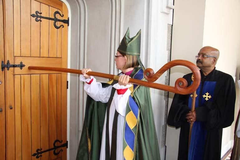 The ancient rite of installation. Bishop Helen-Ann strikes the door of the cathedral three times with her pastoral staff, and the doors are opened.