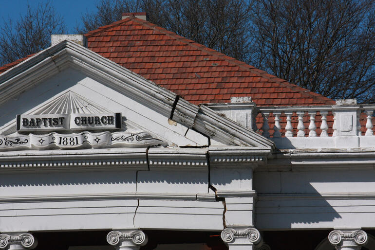 Close up of the damage above the portico of the Oxford St Baptist Church