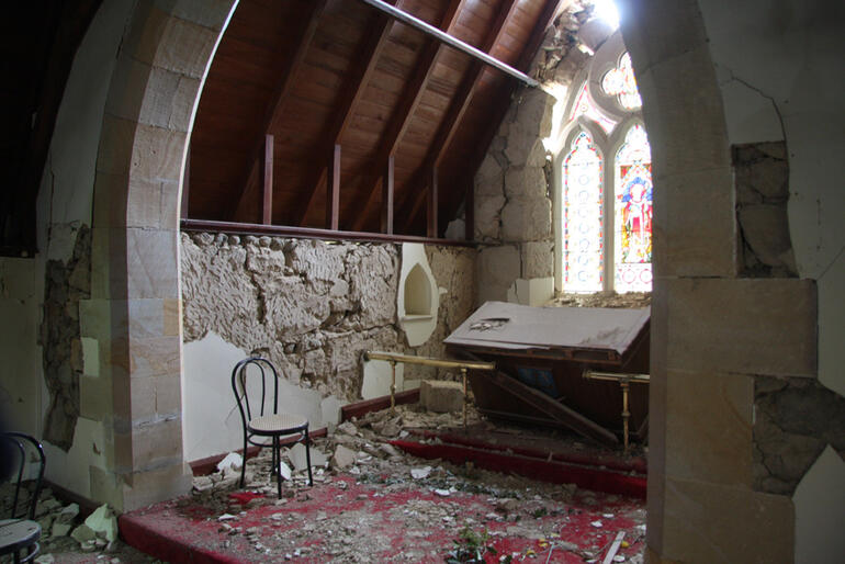 St Cuthbert's, Governors Bay - falling masonry has toppled the altar, and the stained glass window is in jeopardy.