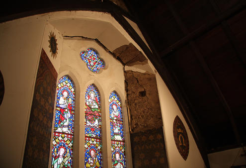 The trifoil stained glass window above the altar at Holy Trinity Lyttelton - which is on the verge of falling out.