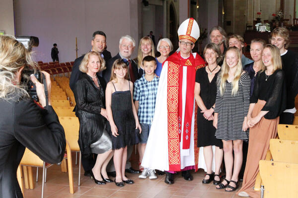 Bishop Jim with his extended family. Jane is beside him, next to their daughter Sophie. Samuel is at the back, far right.