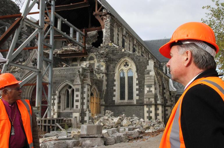 Archbishops David Moxon and Winston Halapua check out the ruins of ChristChurch Cathedral during the bishops' tour of the red zone.