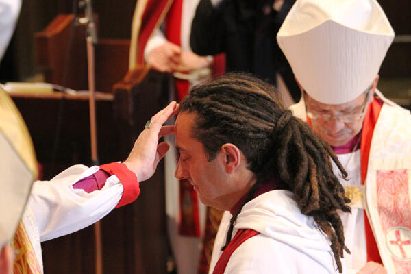 Archbishop David anoints the forehead and hands of the newly ordained bishop.
