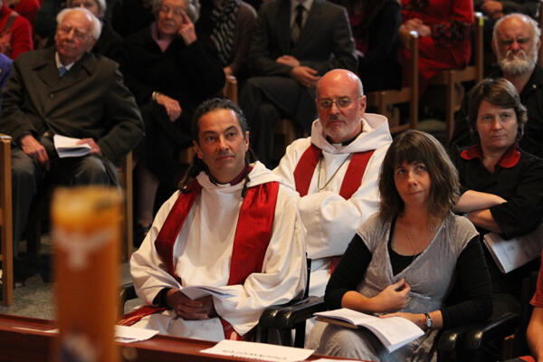Bishop-elect Justin and his wife Jenny listen as Martin and Alison Robinson preach the sermon.