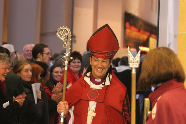 Bishop Justin leaves the cathedral to a standing acclamation.