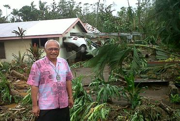 Archbishop Winston Halapua surveys the wreckage of Cyclone Evan in Apia prior to Christmas.