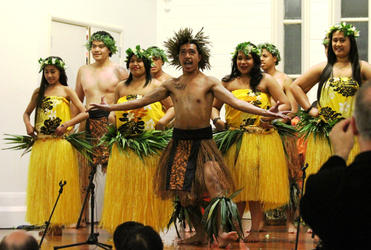 Laamauga Fagu leading a Rarotonga dance performed by a combined group from the Ekalesia Agelekana Samoa, and the Tongan congregation from Otahuhu.