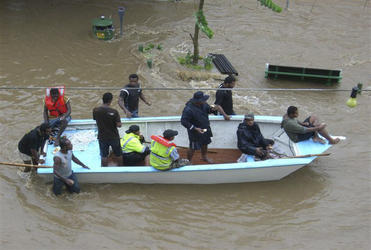A boat joins the rescue effort in Nadi.