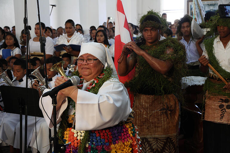 Sr Mele Fehoko, of the Community of the Sacred Name, leads the gospel procession into church.