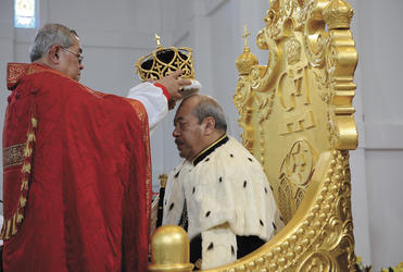 Archbishop Jabez places the crown on Tonga's new King.