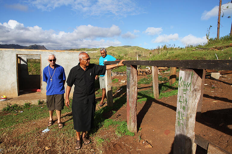 Archbishop Halapua inspects the remains of the school dormitory. That's Mike Hawke at left, and John Simmonds, Diocesan Secretary, at right.