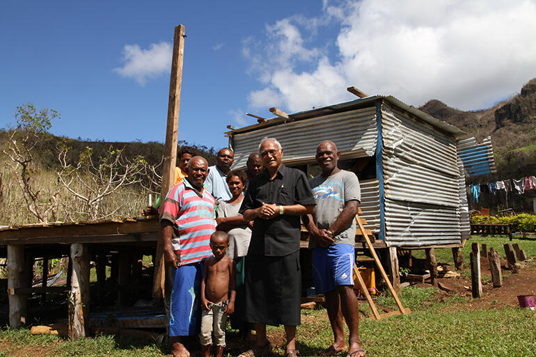 Archbishop Winston with Mosese Kakaramu (left). The Maniava community would meet in his house for worship.