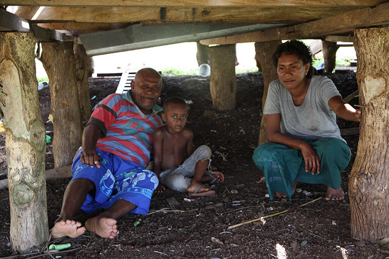 Mosese Kakaramu lies among the pilings of his house, where eight members of his family sought shelter from the storm.