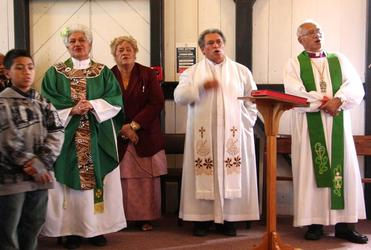 The last hymn. L - R: local lad; Archdeacon Tai; Christina Tapu; The Rev Frank Smith (conducting) and Bishop Winston Halapua.