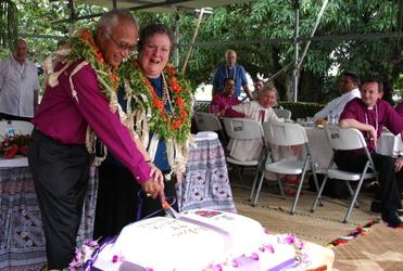 Archbishop Winston and Sue Halapua cut the commemorative cake. Lunch was served in prefab shelters in the cathedral grounds.