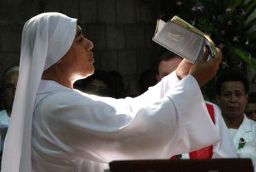 Sr Kalolaine CSN, a Tongan nun working at St. Christopher's Home in Suva, bears the Bible for the reading of the Gospel.