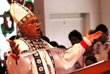 Glory to God, Glory to God, Glory to the Father: Bishop Winston Halapua gathers the community.