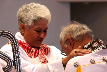 Tai blesses her Bishop, Winston Halapua, who inspired her commitment to the Anglican Church.
