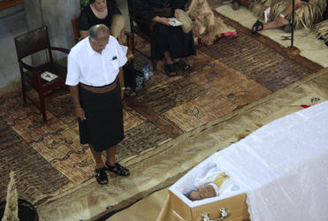 The Fijian President, Ratu Epeli Nailatikau, former commander of the Fijian military forces, pays his respects.
