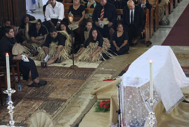 The late bishop's two children, Jonathan and Fitaloa, are in the front of the seated group - with Prince Tungi, of Tonga, at left.