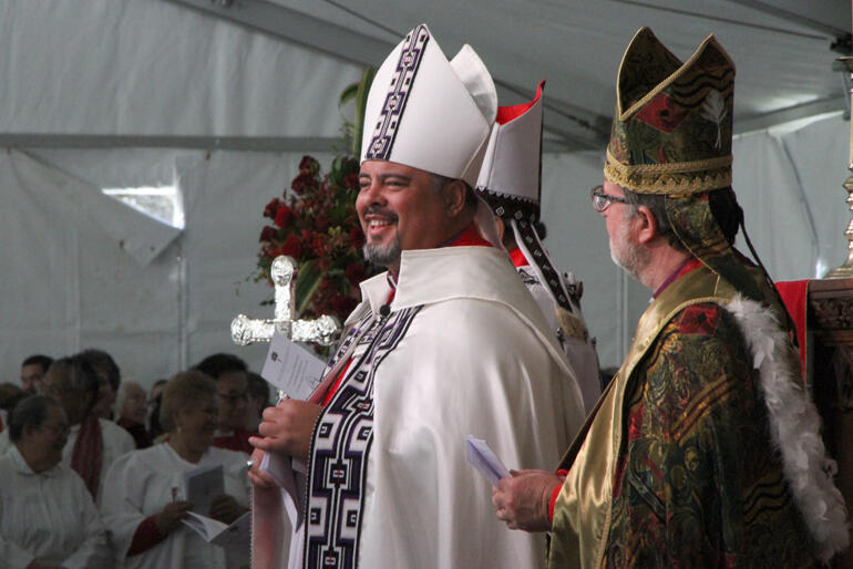 Archbishop Don pauses proceedings to make sure everyone is smiling.