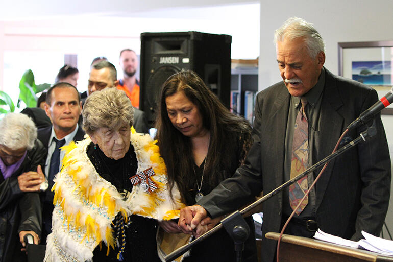 A prayer seeking God's blessing: May, Tina Mackey (May and Dave's daughter) and Rev Nehe Dewes, long-time Mt Eden prison chaplain.