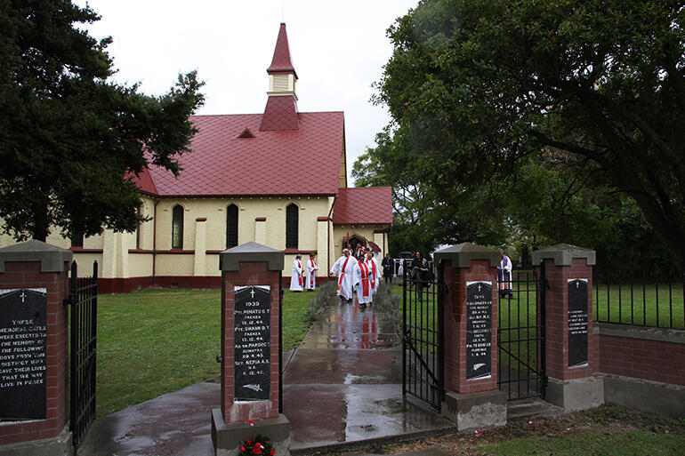 Toko Toru Tapu church, as seen from its war memorial gates, is one of four fully-carved churches in Aotearoa.