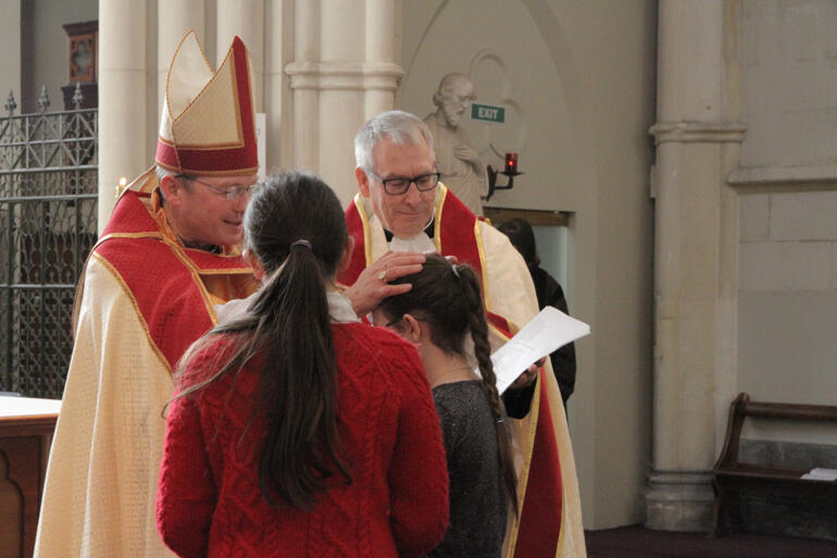 A joyous moment for St Paul's as Bishop Steven confirms Ziva Curtis at St Joseph's Cathedral – after the chaos caused by last week's fire.