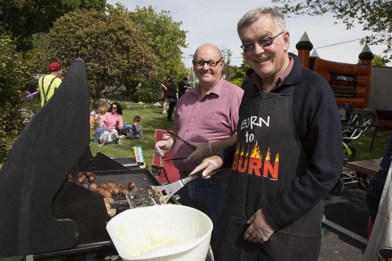 Parishioners fire up the BBQ for All Souls' family-fun opening day