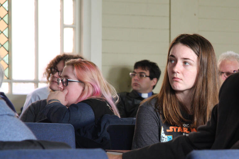 Sophie Cawood (right), one of the young adults who chaired each session, listens to Rev Anne van Gend.