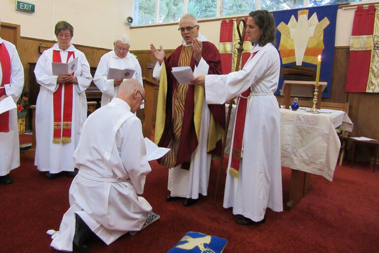 Bishop Jim prays during David Crawley's ordination to the Holy Order of Deacons at St Francis' Titirangi in 2015
