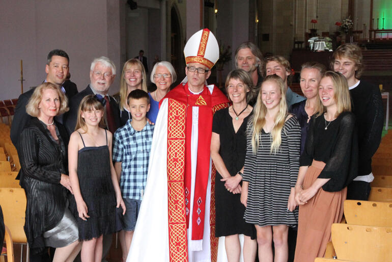 Bishop Jim White stands surrounded by whānau at his ordination as Asst. Bishop of Auckland in 2011. Photo: Lloyd Ashton
