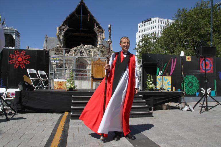 Bishop Peter Carrell faces the city and diocese in Cathedral Square following his installation in front of the ruined cathedral.