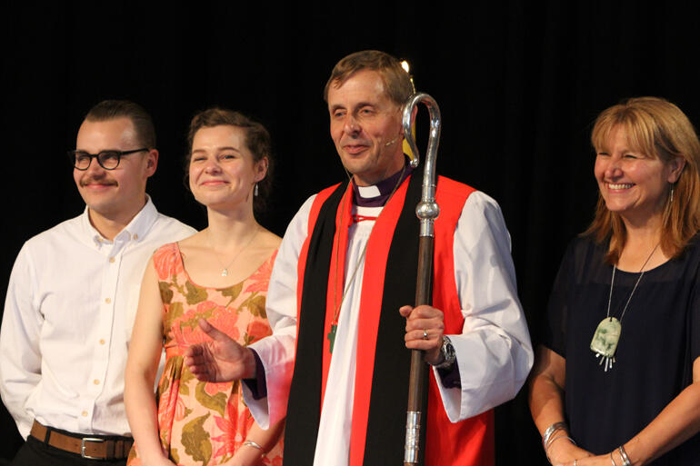 Peter turns to the people after his ordination as ninth Bishop of Christchurch L-R: Andrew, Bridget and Peter Carrell, Teresa Kundycki-Carrell.