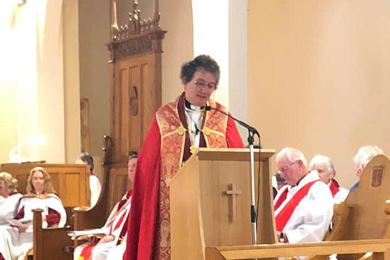 Dean Wendy Scott addresses the congregation at St Peter's from the Cathedral lectern.