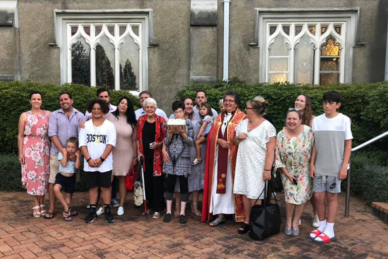 Dean Wendy Scott lines up outside the Waikato Cathedral of St Peter with her whānau supporters.