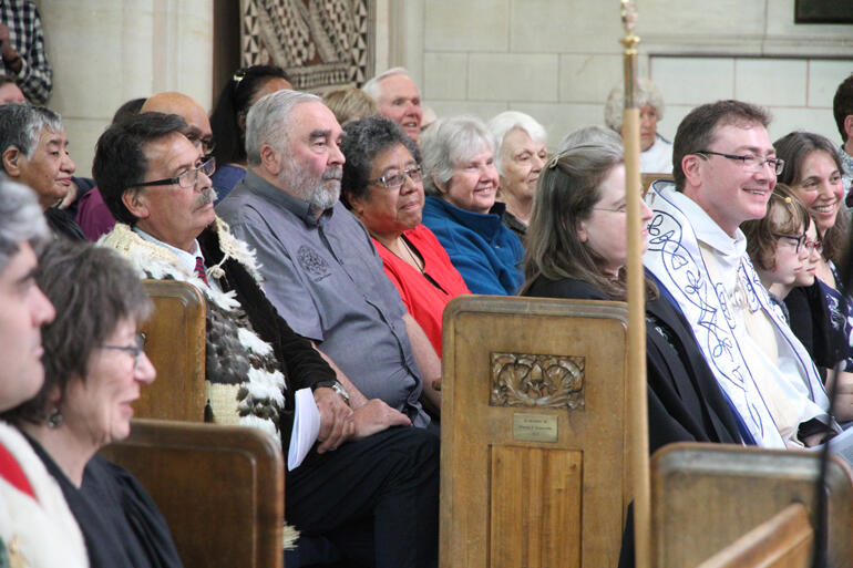 L-R: Prof. John Broughton (Ngai Tahu) and S.Paul's Thursday Hākari Tapu congregation back Dean Tony Curtis and his family at St Paul's Cathedral.