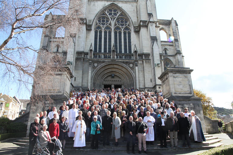 Anglicans pour out onto the steps of St Paul's Cathedral into the Spring sunshine.