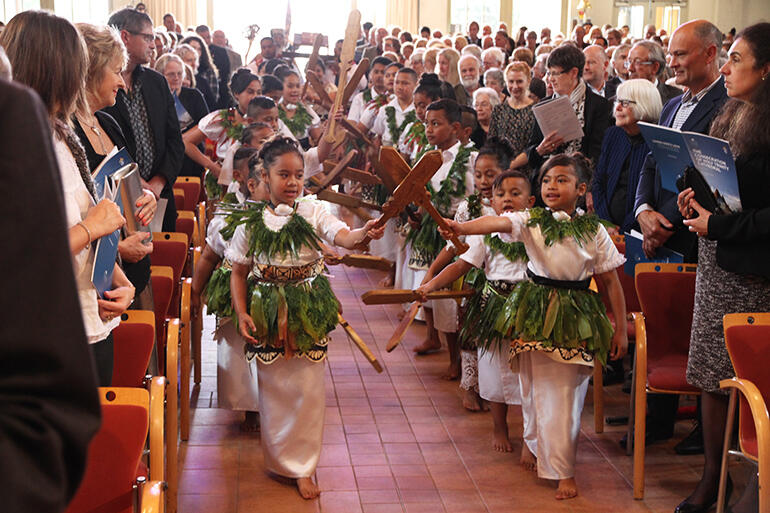 Lights, camera, action! Children from the Diocese of Polynesia form the vanguard for the gospel procession.