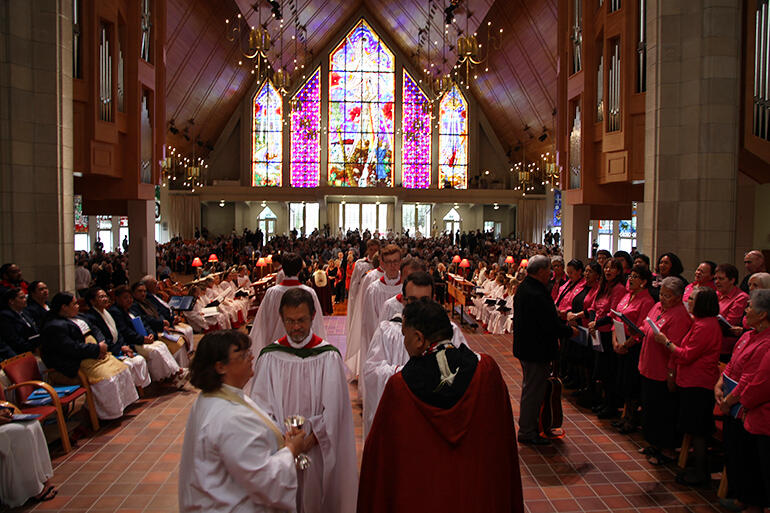 Three-part harmony - the Tongan choir at left, the Cathdral choir in white robes - and the Auckland Anglican Maori Choir at right.
