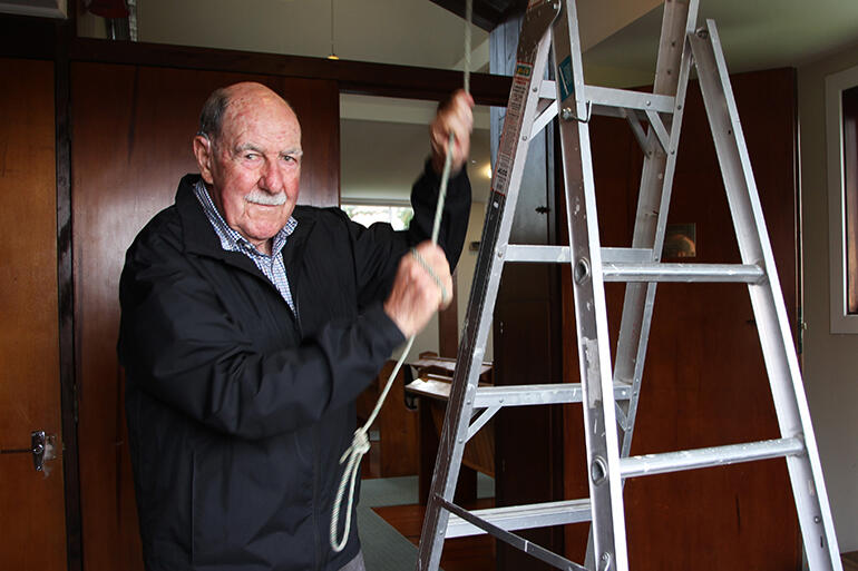 Frank Bartley, the man who reconnected the rope, has just threaded it back down through the foyer ceiling.