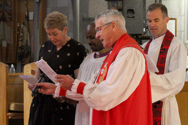 Jenny Dickie, Rev Simon Martin and Bishop Richard Ellena present Rev Steve Maina to be ordained bishop.