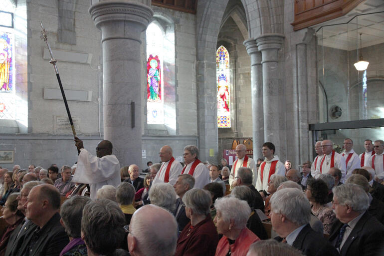 The first of scores of diocesan and visiting clergy process into Christ Church Cathedral.