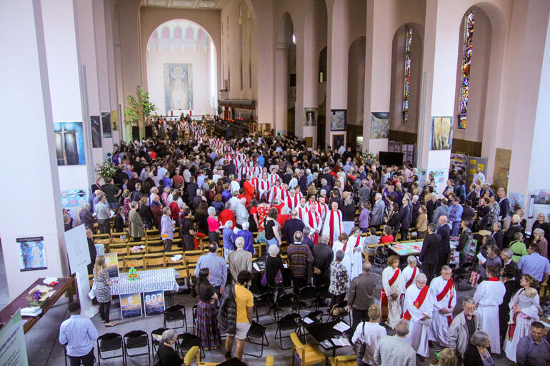 Clergy file out of the diocesan service of thanksgiving after the ordinations.