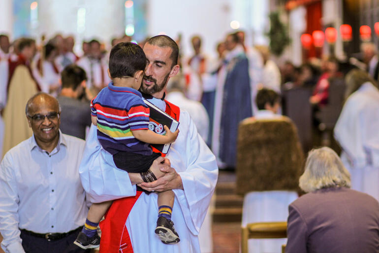 On the way to being priested, Rev Paul Fletcher of Urban Vision picks up his son Ishmael.