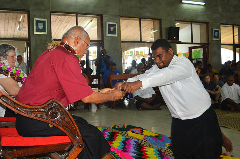 Archbishop Winston is served kava during the traditional ceremony which took place after the church service.