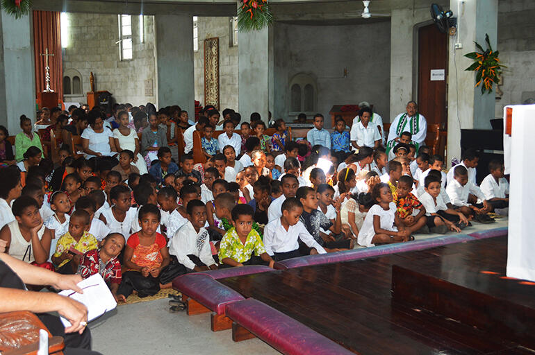 The children gathered behind the altar.